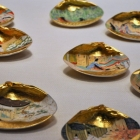 """A lowly clam elaborately painted, part of a """"memory"""" game"""